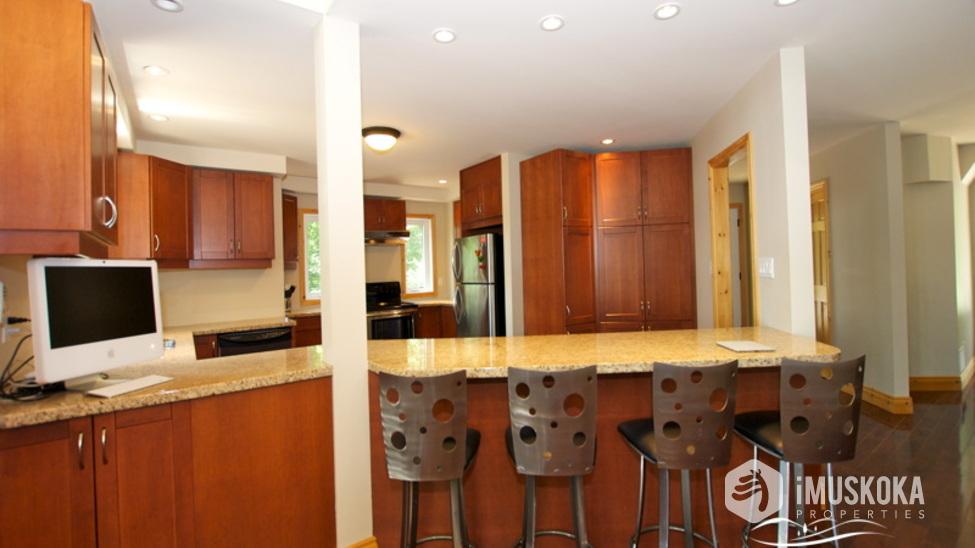 Open concept social kitchen with breakfast bar Breakfast bar