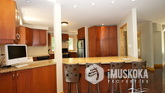 Open concept social kitchen with breakfast bar