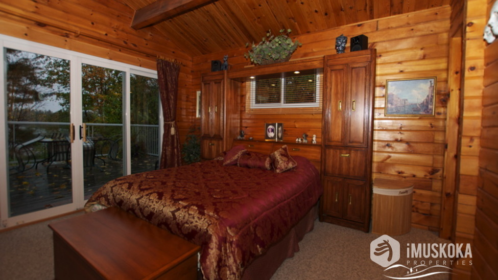 Master Bedroom Pine log with a walk out to deck and ensuite