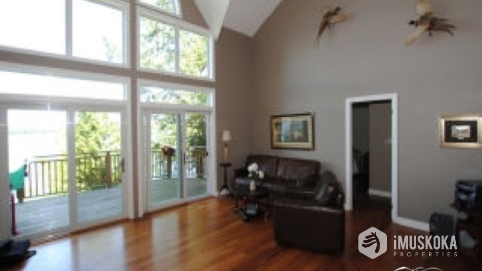 Great room with Cathedral Ceilings Cathederal ceilings, hardwood floors, beautiful views.