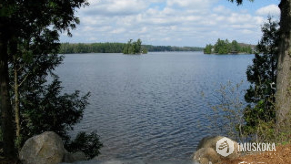 Great west views, protected by island Beautiful sand shore for kids to play on Lake Muskoka.