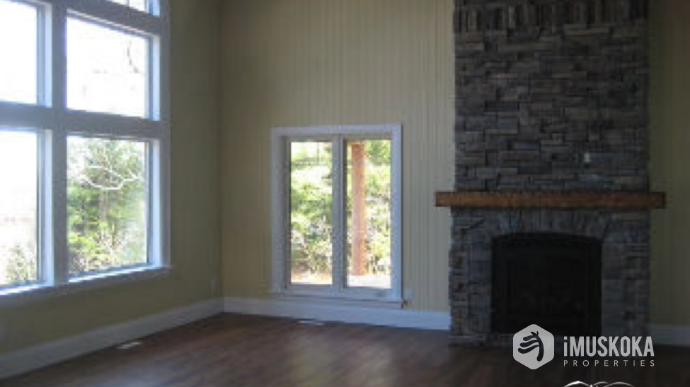 Cathederal Ceilings, hard wood Living room with muskoka fireplace