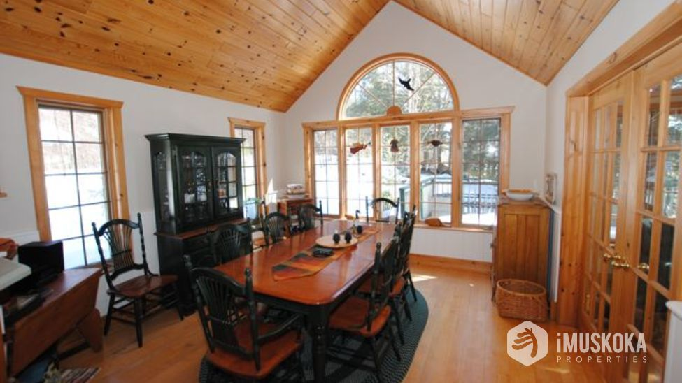 Dining Room Dining room with pine ceiling and floors. Muskoka room to right side.